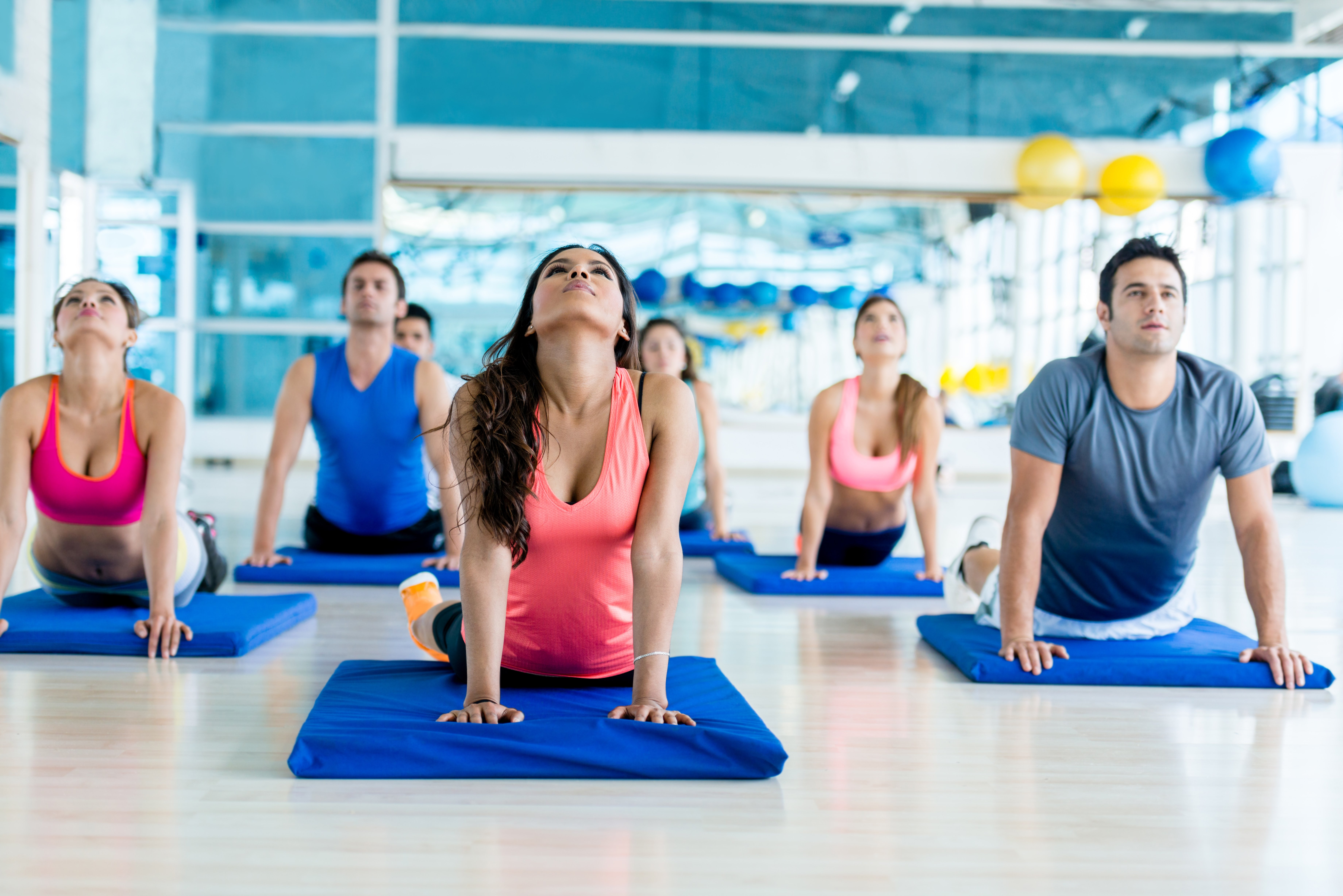 Group of people at the gym in a yoga class-1